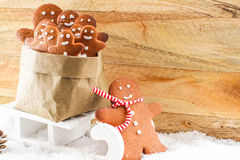 Gingerbread man pulling sled with a bag Stock Photography