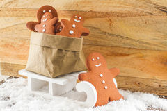 Gingerbread man pulling sled with a bag Royalty Free Stock Image