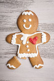 Gingerbread man with red heart and broken leg Royalty Free Stock Photos