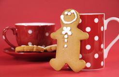 Gingerbread man with red polka dot coffee mug and tea cup Royalty Free Stock Image