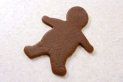 Gingerbread man shape in cookie dough Stock Photo