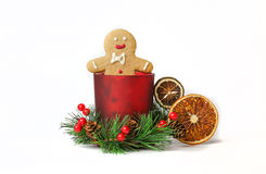 Gingerbread man sitting in New Year's decoration Royalty Free Stock Photography