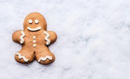 Gingerbread man on snow , top view with copy space. royalty free stock image