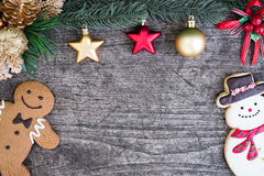 Gingerbread man with snowman cookie and fir tree Stock Photography