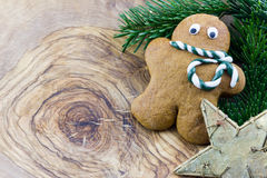 A gingerbread man, a star and pine branches Stock Photography