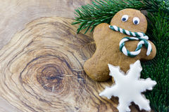 A gingerbread man, a star and pine branches Stock Image