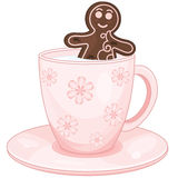 Gingerbread man take a milk bath in cup Royalty Free Stock Photos