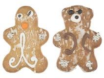 Gingerbread man and a teddy bear Stock Photos