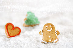 Gingerbread man and tree on a festive Christmas snow background Stock Photos