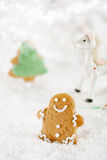 Gingerbread man and tree on a festive Christmas snow background Stock Photography