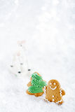 Gingerbread man and tree on a festive Christmas snow background Stock Images