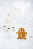 Gingerbread man and tree on a festive Christmas snow background Royalty Free Stock Photography