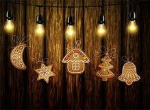 Gingerbread man tree and stars. Gingerbread man tree bell half moon and stars with decorations Cristmas background on wood Vector royalty free illustration