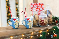 Gingerbread Man with two blue cups - Christmas Holiday Background royalty free stock images