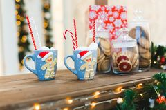 Gingerbread Man with two blue cups - Christmas Holiday Breakfast Background royalty free stock image