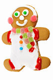 Gingerbread man. Wearing white icing clothes, a gumdrop scarf and ear muffs, and a big smile Royalty Free Stock Photography