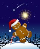 Gingerbread man wih a sparkler. Isolated raster version of the  gingerbread man with a sparkler in winter fir forest Stock Photos