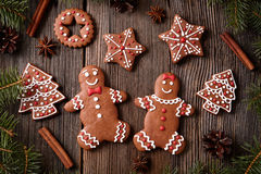 Gingerbread man and woman couple, fur trees, star Royalty Free Stock Photos