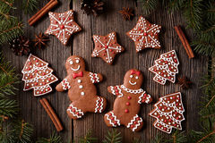 Gingerbread man and woman couple, fur trees, star Stock Images