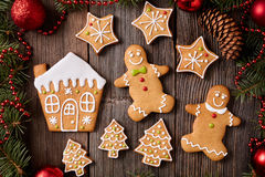 Gingerbread man and woman, house, fir trees, stars Royalty Free Stock Photography