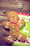 Gingerbread Man on Wood. Christmas Holiday Background with Gingerbread Cookie, decorative snowflakes and napkin.  royalty free stock images