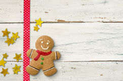 Gingerbread man on a wooden background Stock Photography