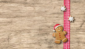 Gingerbread man on a wooden background Royalty Free Stock Photos