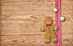 Gingerbread man on a wooden background Stock Images