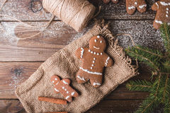 Gingerbread man on a wooden background and sacking on wooden background. Royalty Free Stock Photos