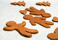 Gingerbread men. Christmas cookies: gingerbread men, hearts and christmas trees Royalty Free Stock Photos