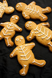 Gingerbread Men. A group of baked gingerbread men on a black cloth background stock photography