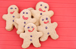 Gingerbread men. On red background Stock Photos