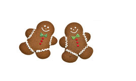 Gingerbread Men. Two gingerbread men on white background Stock Image