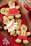 Gingerbread men. On a red platter Royalty Free Stock Photos