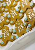 Gingerbread men. Closeup of fresh baked cheerful gingerbread men cookies with decorations Royalty Free Stock Photo