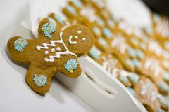 Gingerbread men. Closeup of fresh baked cheerful gingerbread men cookies with decorations Royalty Free Stock Images