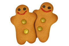 Gingerbread men. Two gingerbread men side by side isolated on white with clipping path Royalty Free Stock Photography