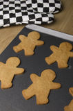Gingerbread Men. Baking gingerbread men at Christmas time Royalty Free Stock Image