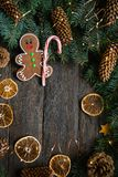Gingerbread men with candy cane snowflakes laying on grey wood background. Christmas or New Year composition. Christmas card. Gingerbread men with candy cane stock images