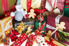Gingerbread men and christmas gifts Stock Photo