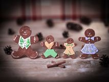 Gingerbread men and cinnamon sticks on the Christmas table . royalty free stock images