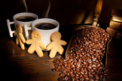 Gingerbread men and coffee Stock Image