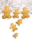 Gingerbread men cookies against sparkly white Royalty Free Stock Image