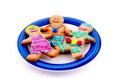 Gingerbread men cookies on a plate Royalty Free Stock Photos