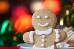 Gingerbread Men Cookies on Table bokeh background Stock Photos