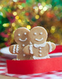 Gingerbread Men Cookies on Table bokeh background Royalty Free Stock Photo