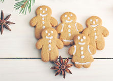 Gingerbread men cookies on wooden background Stock Photography