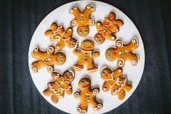 Gingerbread men on a dark background Stock Photos