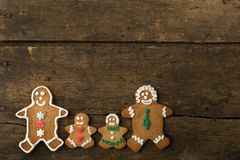 Gingerbread men family on wood stock photography