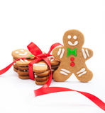 Gingerbread Men. Happy Christmas gingerbread cookies on white. Some cookies tied with red ribbon to make a delicious gift stock photos